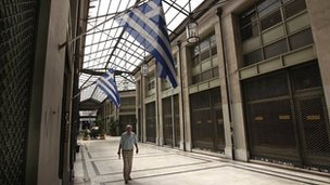 Arcade of shops with &quot;for sale&quot; signs on their windows in Athens (22 August 20120)