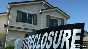 A foreclosure sign is posted in front of a home for sale in Stockton, California 29 April 2008