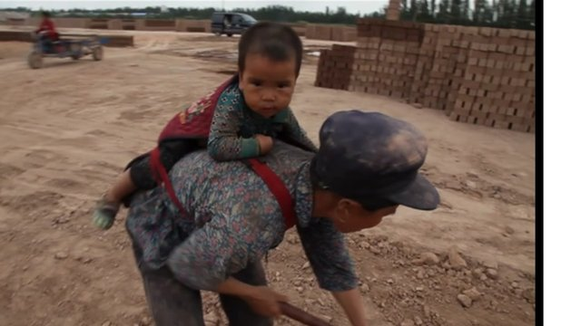 Brick factory worker and child