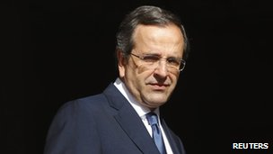 Greek Prime Minister Antonis Samaras waits to meet Eurogroup Chairman Jean-Claude Juncker in Athens, 22 August
