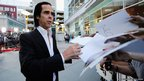 Screenwriter and composer Nick Cave signing autographs