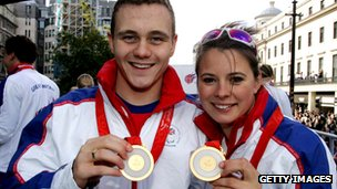 Sam Hynd and Liz Johnson with the Olympic medals  they won in Bejing in 2008