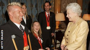 Queen Elizabeth II chats to triple gold medallist equestrian Lee Pearson during a reception for the Great Britain Paralympic team at Buckingham Palace