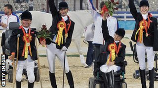 Anne Dunham, Sophie Christiansen, Lee Pearson and Simon Laurens of Great Britain celebrate after winning the Gold Medal of Overall Team at Hong Kong Olympic Equestrian Venue in 2008