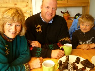 Eva Nordfjell (l), Magne Haugom and their son on their reindeer farm