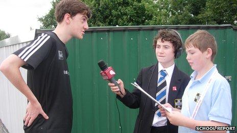 Tie-down crew member Tom talks to School Reporters