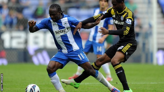 Wigan forward Victor Moses (left) in action against Chelsea