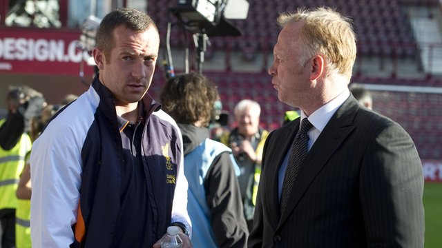 Liverpool midfielder Charlie Adam chats to Alex McLeish