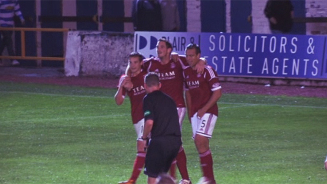 Aberdeen players celebrate at Cappielow