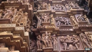 Khajuraho Temple - sculptural sexual scenes depicted on the Temple wall
