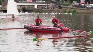 Firefighters taking part in a mock river rescue