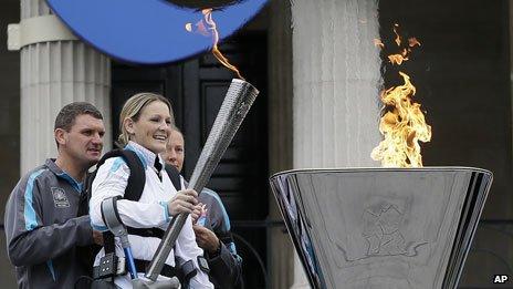 Claire Lomas lights the cauldron in Trafalgar Square
