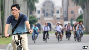 Students riding bicycle in the campus of National Taiwan University in Taipei (file photo)