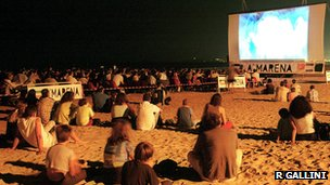 A film being shown on a beach on the Riviera Romagnola