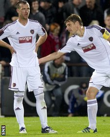 Hearts defender Andy Webster is given encouragement by captain Marius Zaliukas