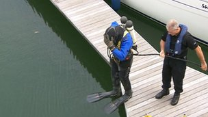 A police diver ready to search the marina