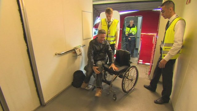 Frank Gardner getting off the plane in Stockholm