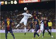Real Madrid's Cristiano Ronaldo heads a football during a match against Barcelona