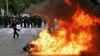 Argentinian riot police remain behind a fire during clashes with demonstrators