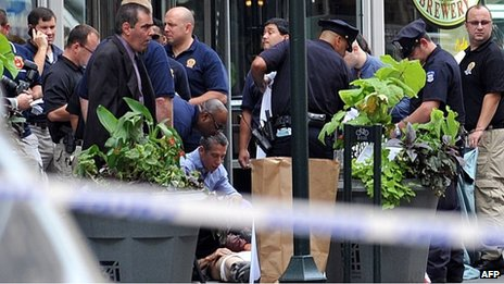 Police and a victim at the scene of a shootout in front of the Empire State Building, New York 24 August 2012