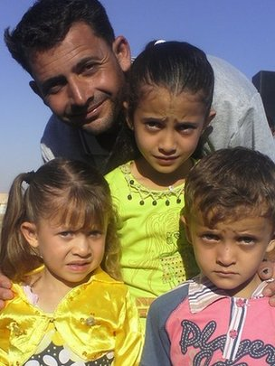 Ahmed Yassin and his three children in Zaatari refugee camp