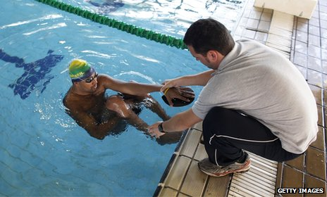 Paralympic swimmer with coach
