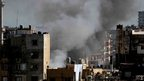 Smoke billows from a building in the Lebanese city of Tripoli (24 August 2012)
