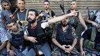 Gunmen speak to reporters in the Bab al-Tabbana district of Tripoli (22 August 2012)