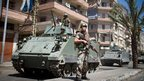 A Lebanese army soldier stands on a street in Tripoli (23 August 2012)