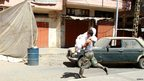 A man carries a woman wounded in the fighting in the Sunni district of Bab al-Tabbana, Tripoli (22 August 2012)
