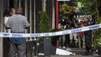 Body lies on pavement at scene of shooting in New York. 24 Aug 2012