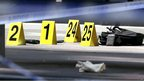 Markers are placed next to items of evidence at the scene. 24 Aug 2012