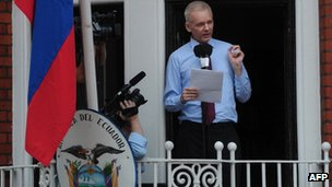Julian Assange speaks on the balcony of Ecuador's UK embassy
