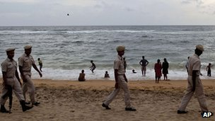 Sri Lankan coastguards patrol a beach in a Colombo suburb