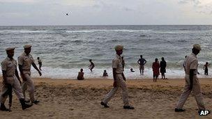Sri Lankan coastguards patrol a beach in a Colombo suburb