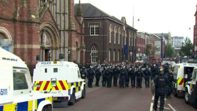 Police officers in riot gear outside church