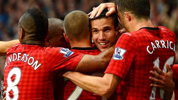 Robin van Persie congratulated by team-mates