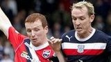 Ross County's Scott Boyd competes with Dundee's Gary Irvine