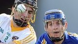 Antrim's Ronan McCloskey and Padraic Collins of Clare