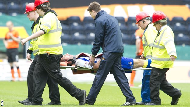 Gary Harkins is taken off on a stretcher