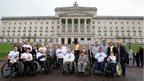 Paralympians and politicians pose with the flame at Stormont
