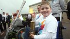 Marc McGarel holds Paralympic lantern