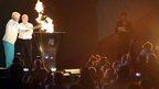 Dr Janet Gray lights cauldron in front of the crowds at Belfast City Hall