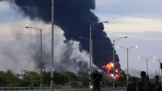 Fire and smoke rise over the Amuay refinery near Punto Fijo, Venezuela