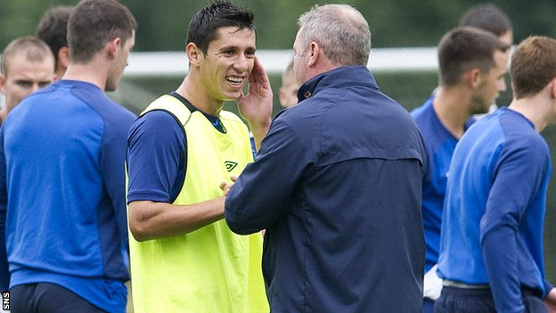 Anestis Argyriou chats with manager Ally McCoist during training