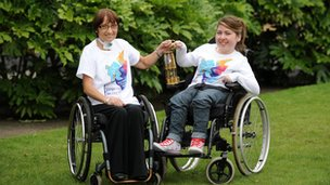 Maggie McEleny and Jodie Taylor with Paralympic flame