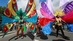Young women take part in the children's day parade at Notting Hill Carnival in west London, August 26, 2012.