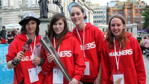 Young reporters Deanna, Rachel, Emma and Naomi with the Paralympic torch in Belfast
