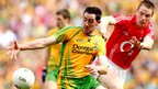 Donegal player Mark McHugh disputes possession with Colm O&#039;Neill of Cork during the All-Ireland semi-final