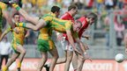Donegal&#039;s Neil Gallagher takes a tumble during his team&#039;s two-point win over Cork in the All-Ireland semi-final